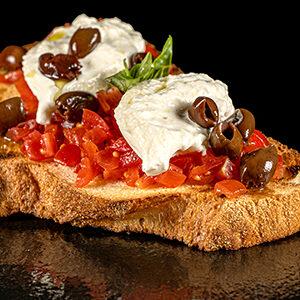 Bruschetta Burratina con pomodorini burrata e olive taggiasche